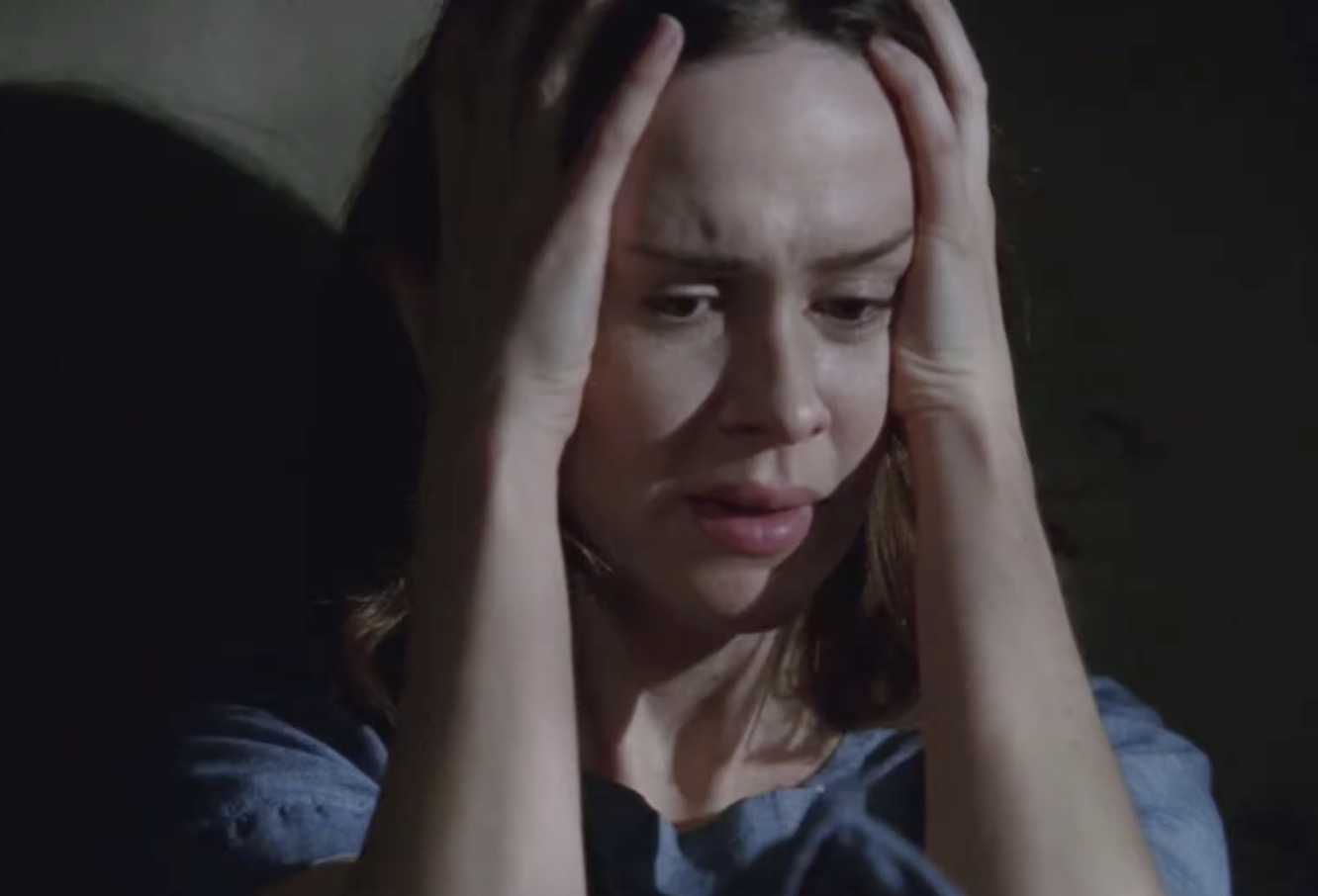 "Lana Winters from ""AHS: Asylum"" nervously putting her hands around her head as a patient in the asylum"