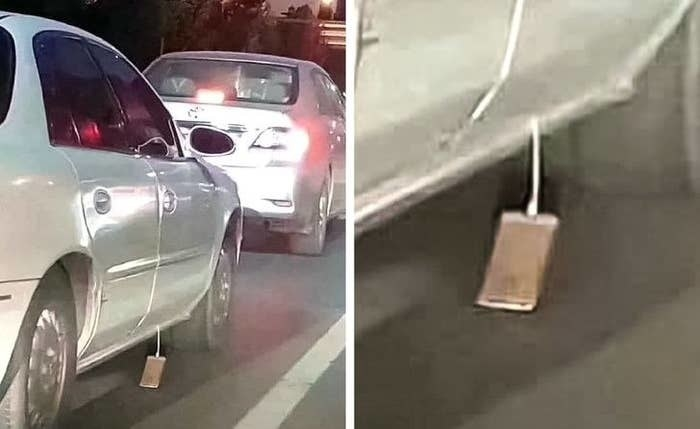 iphone dragging by its cord outside a car