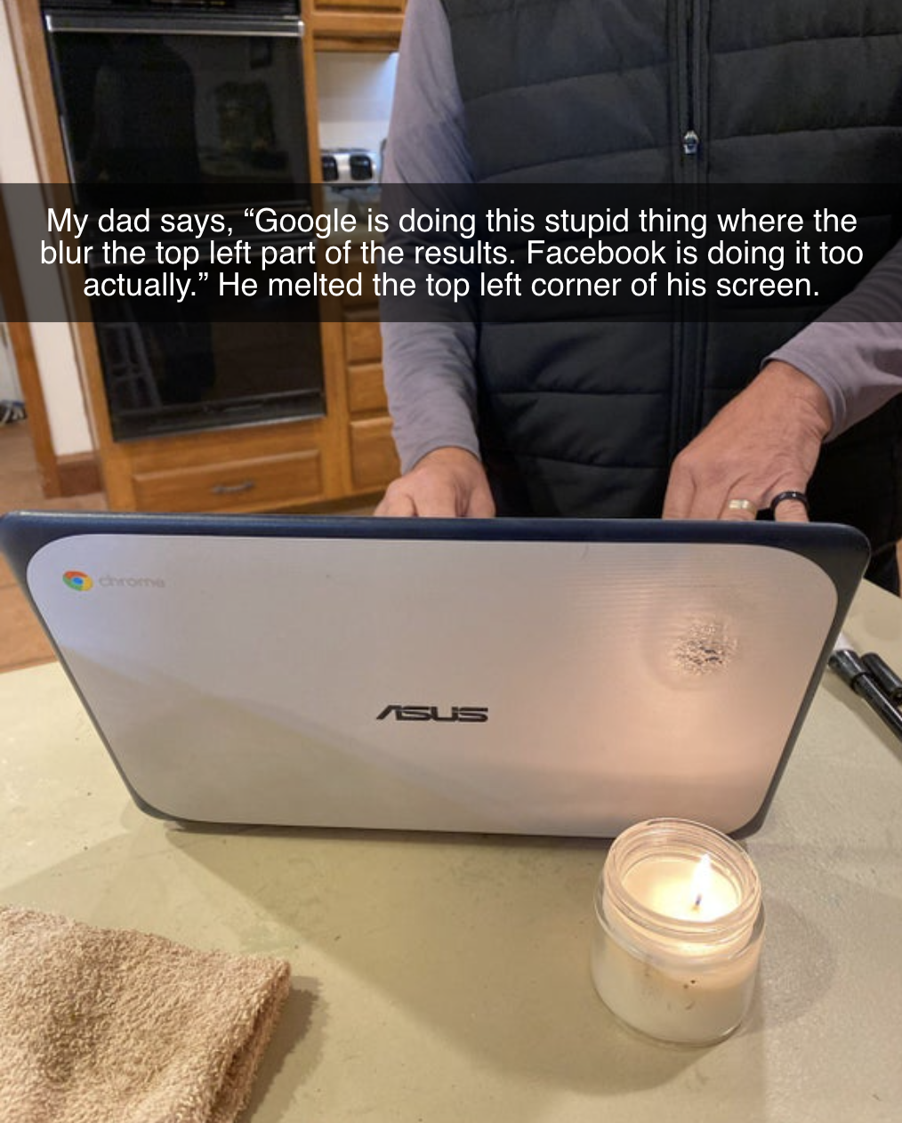 computer next to a candle and there's a burn mark near the candle