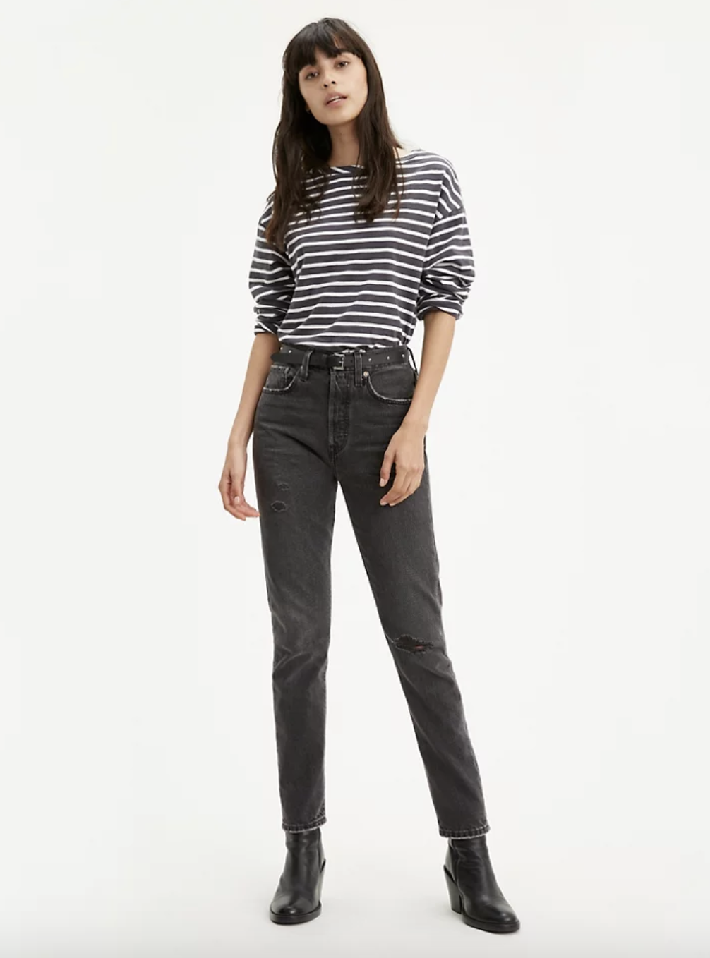 Model in high waisted black skinny jeans