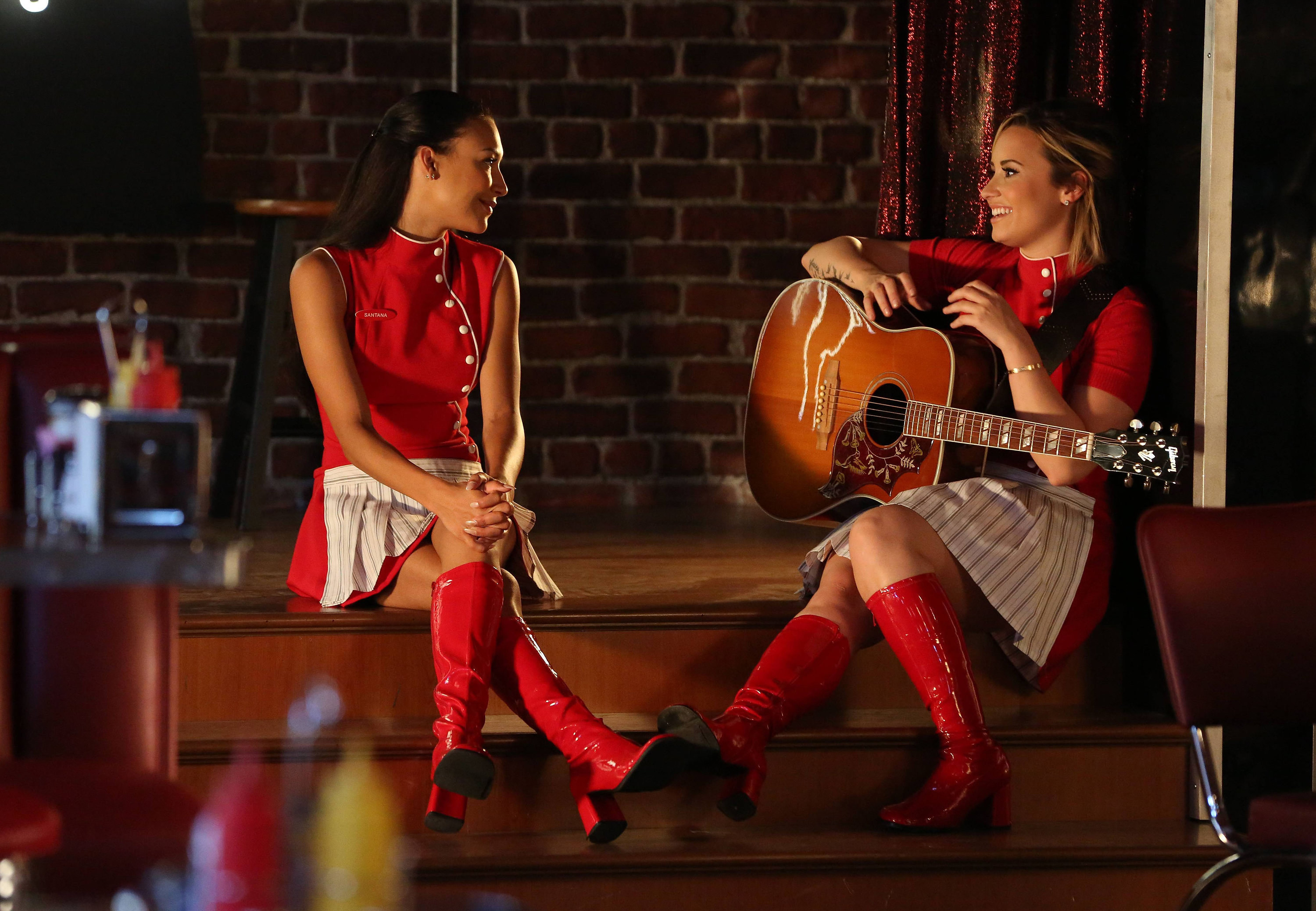 """Naya Rivera and and Demi Lovato in the """"Tina in The Sky With Diamonds"""" episode of GLEE."""