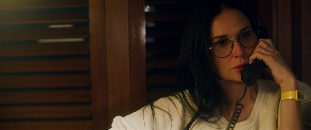 A shot from the film shows Demi Moore speaking on the phone