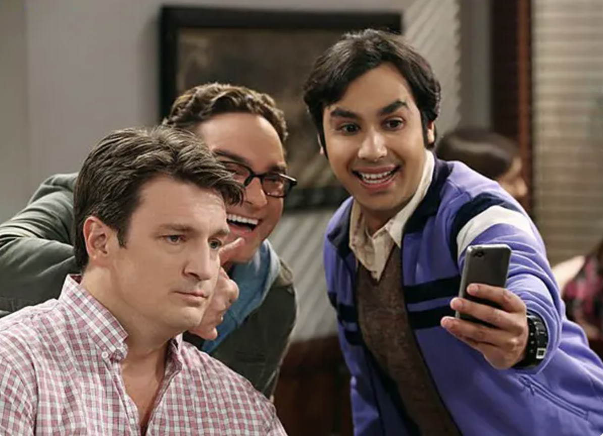 The show's heroes take a selfie with an unhappy Nathan Fillion
