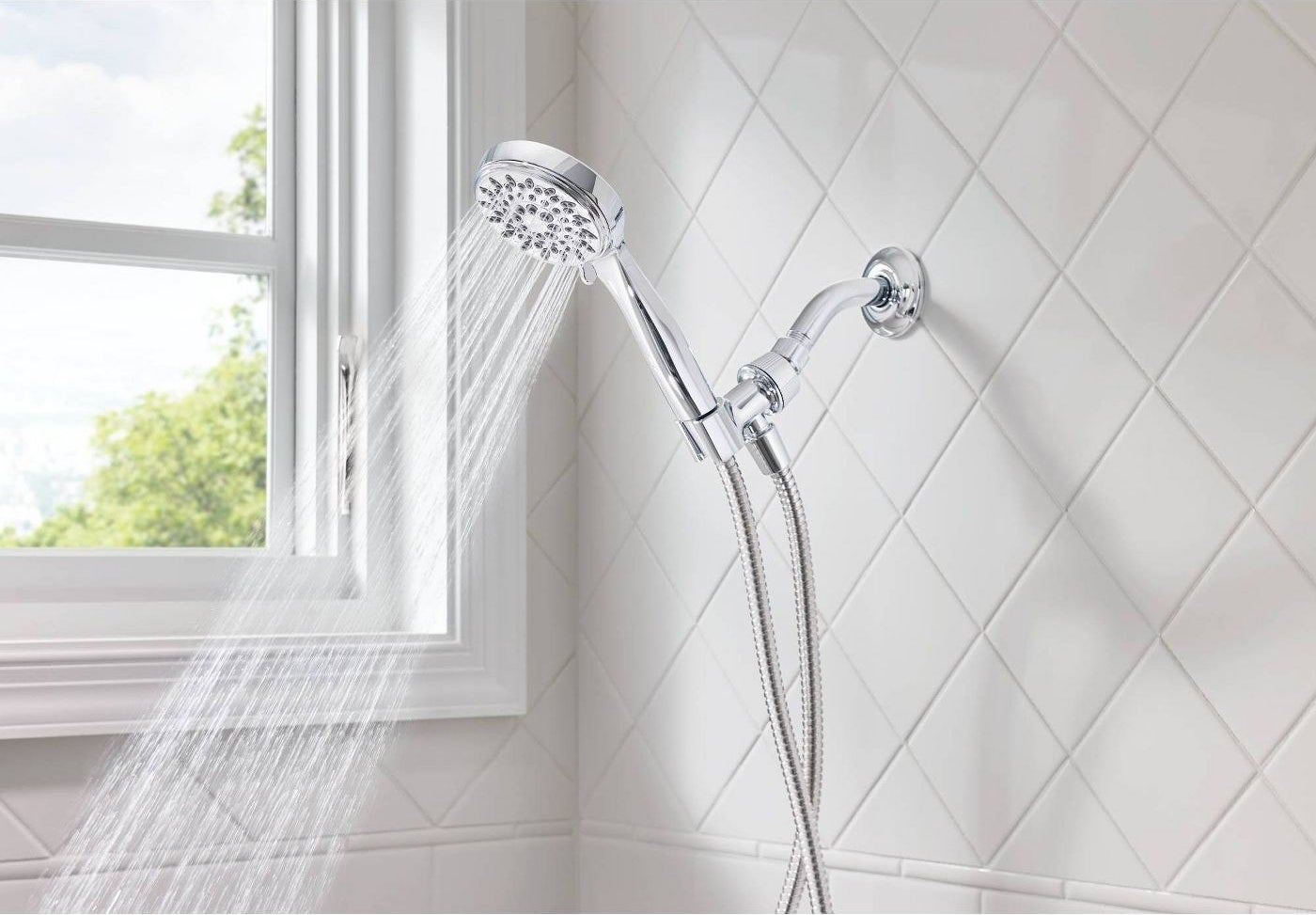 Chrome showerhead inside a white shower