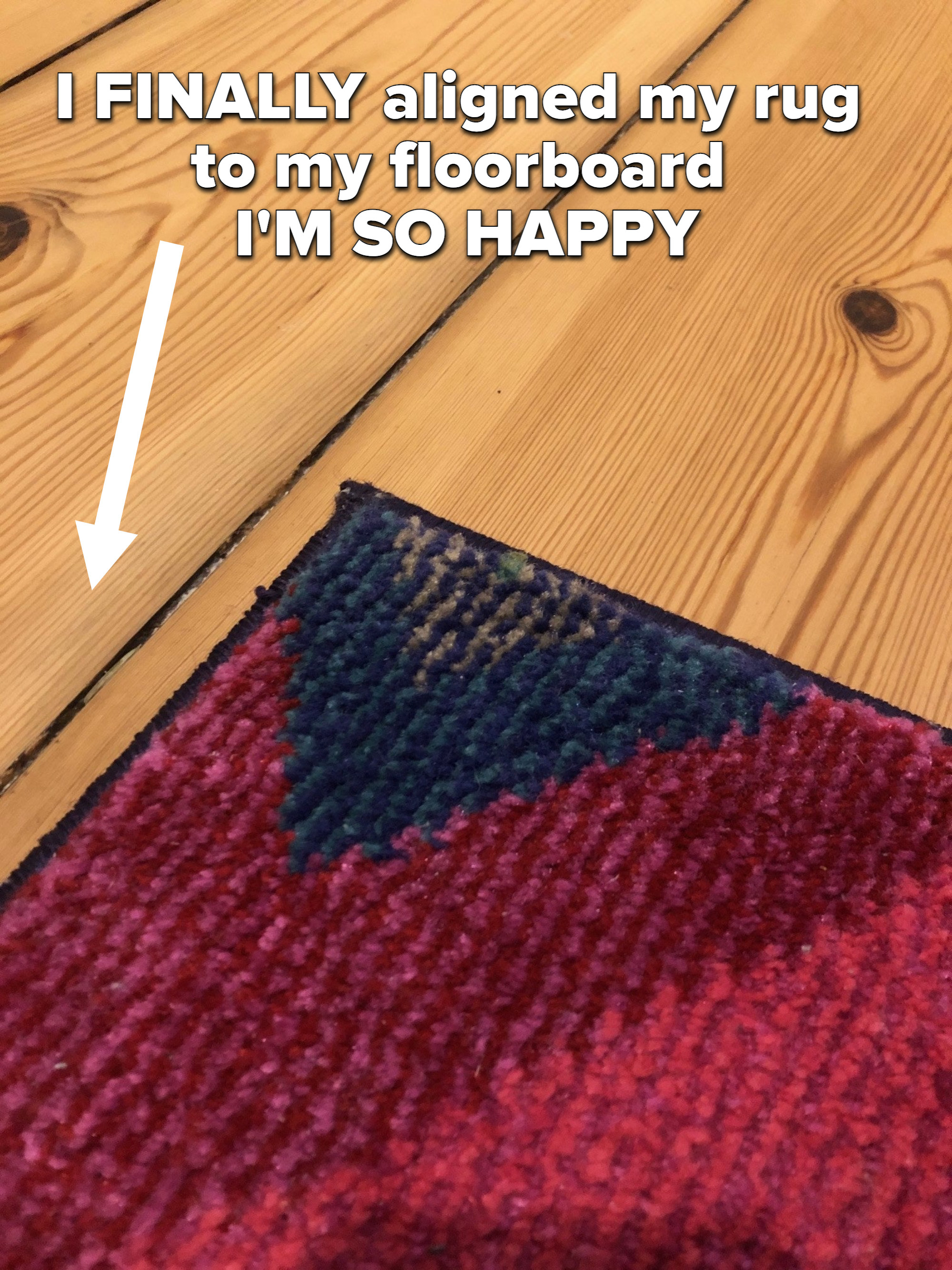 The writer's rug perfectly aligned to the floorboard
