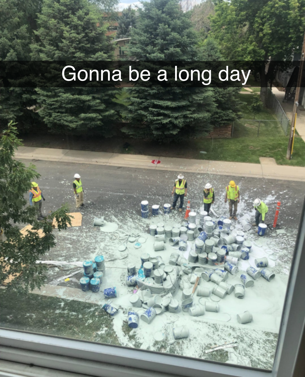 picture of like 25 paint cans upturned in the middle of a road