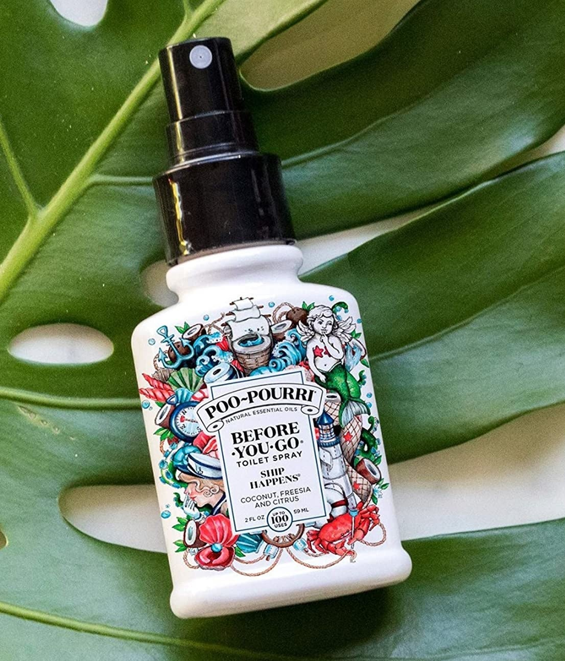 bottle of poo-pourri that says before you go toilet spray ship happens coconut freesia and citrus