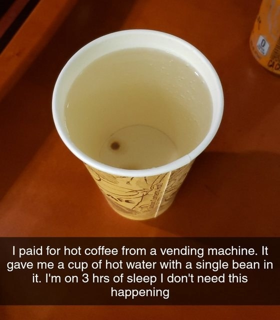 person who got a coffee from a machine but unfortunately it's just a single bean
