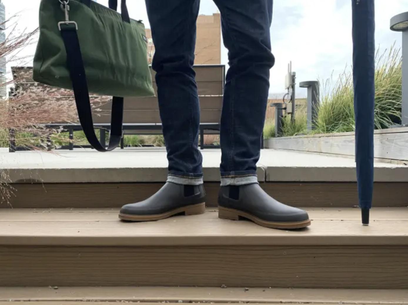 BuzzFeed editor wearing black Hunter waterproof Chelsea boots