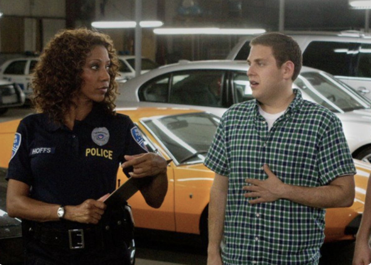 Holly Robinson Peete in a police officer's uniform and Jonah Hill