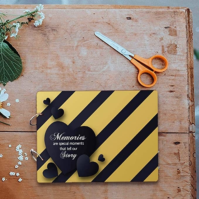 Black and yellow striped scrapbook.