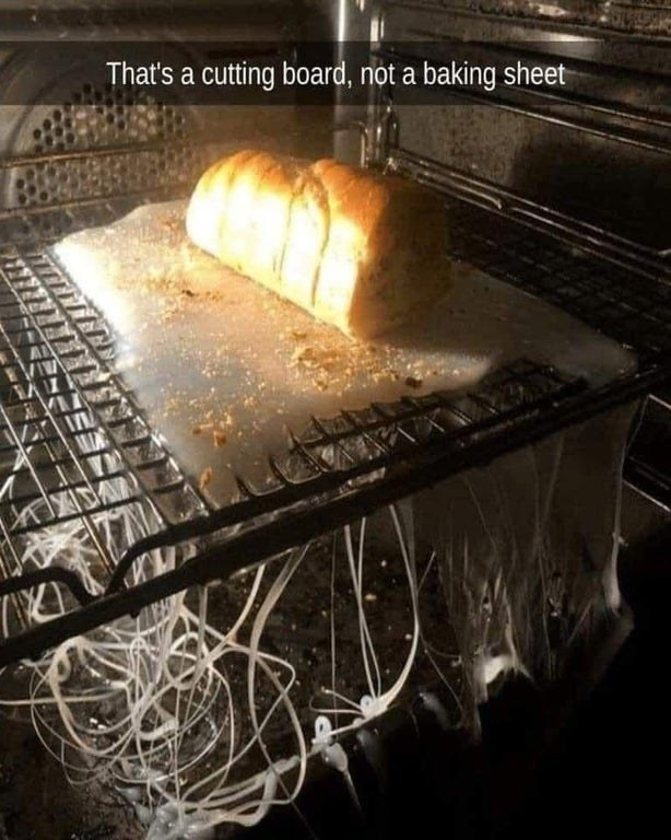 bread on top of a cutting board thats melting in the oven
