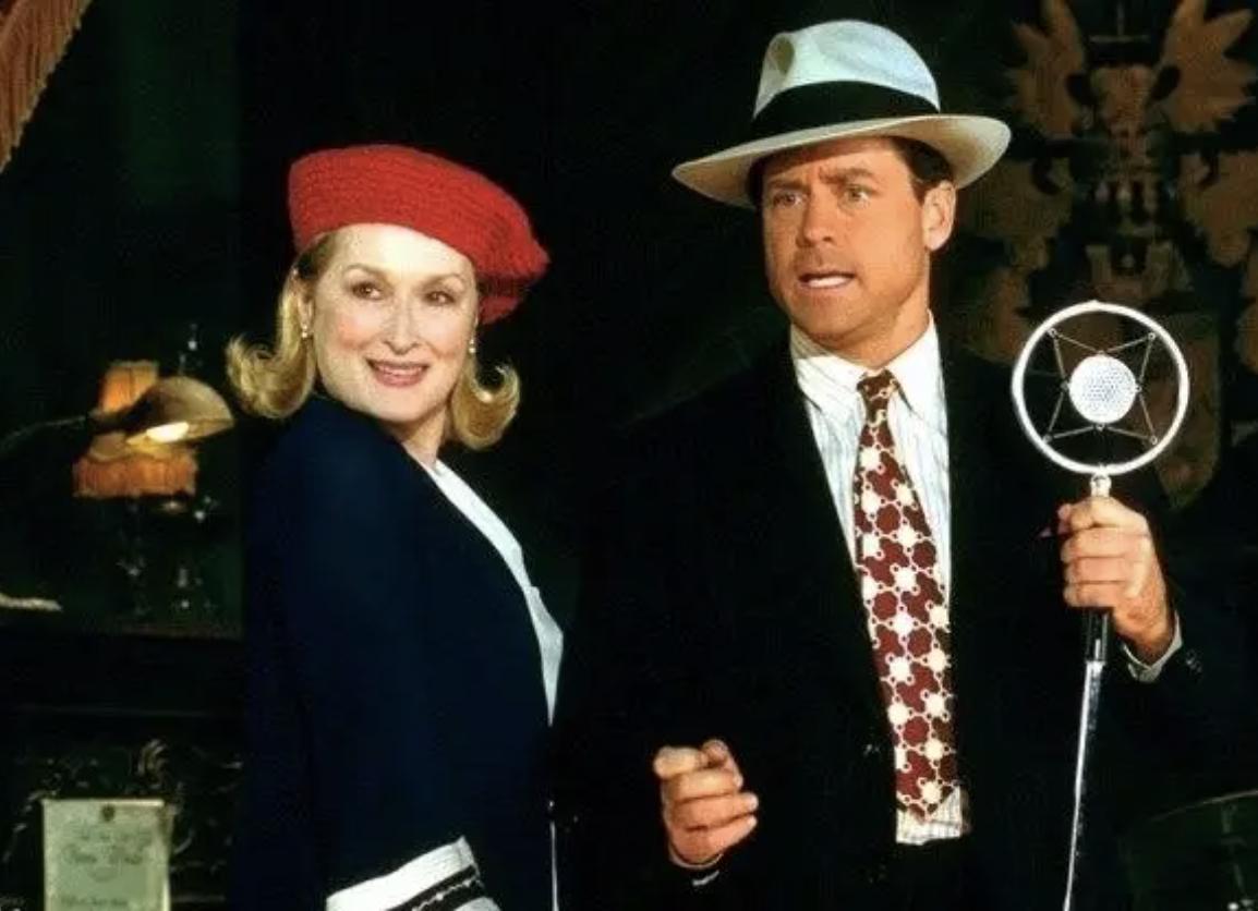 Meryl Streep and Greg Kinnear dressed in 1920s' era clothes