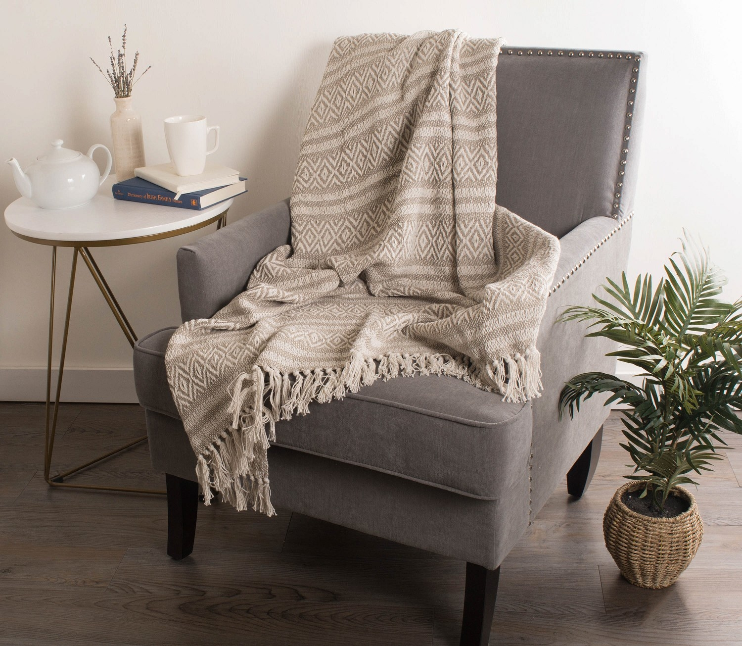 The blanket draped over an accent chair