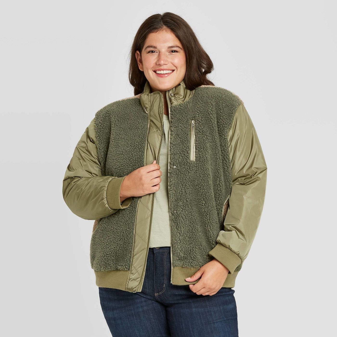 Model in green sherpa jacket