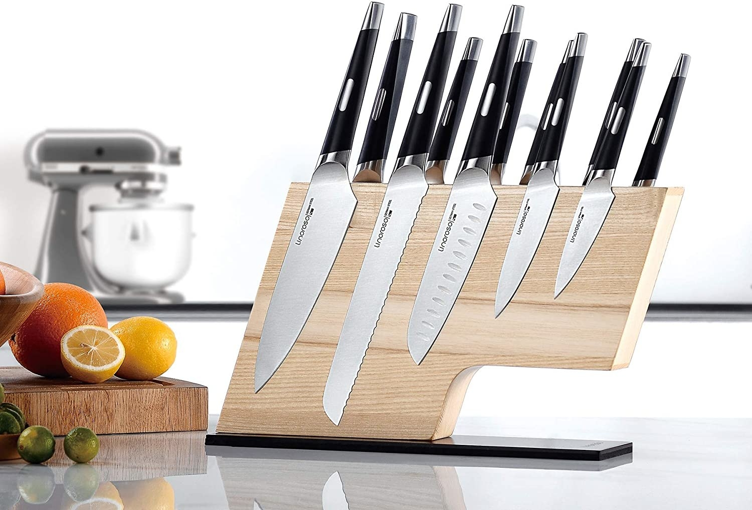 l-shaped wooden board with knives stuck to it