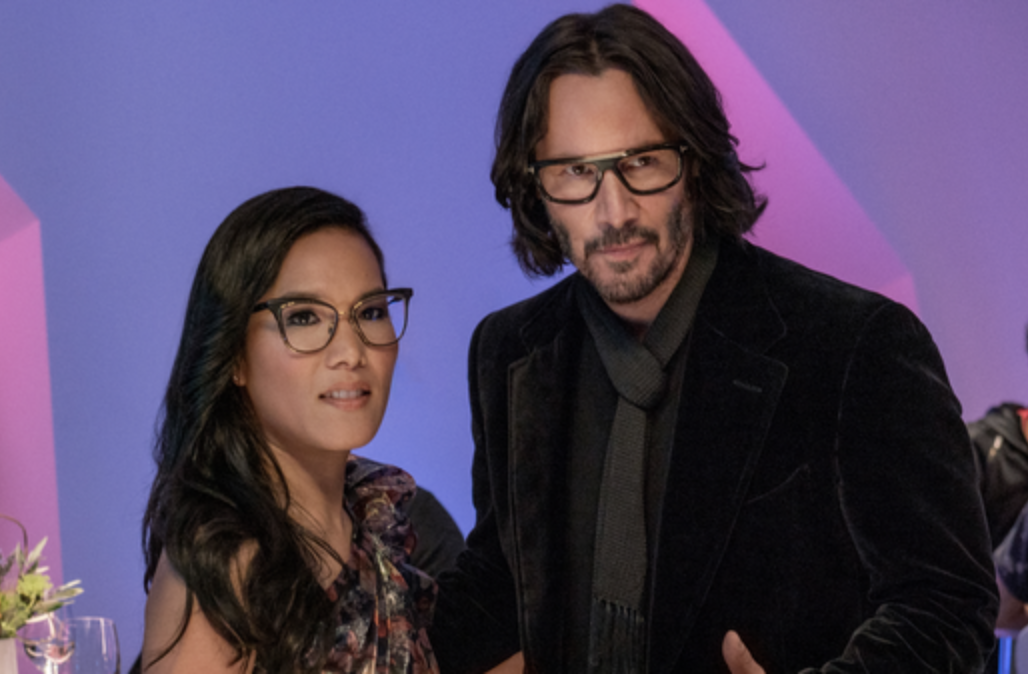 A suave-looking Keanu Reeves stands with a chic Ali Wong