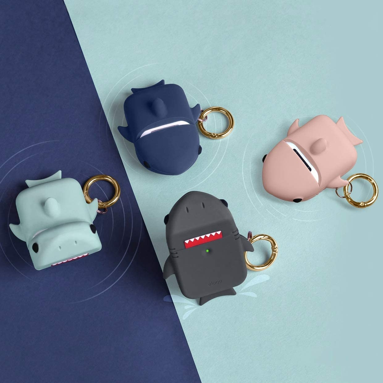 Four shark AirPod cases laid out