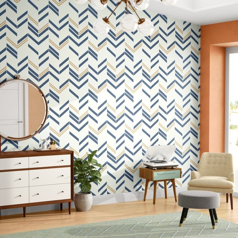 The wallpaper, which is cream with a gold-and-blue chevron pattern