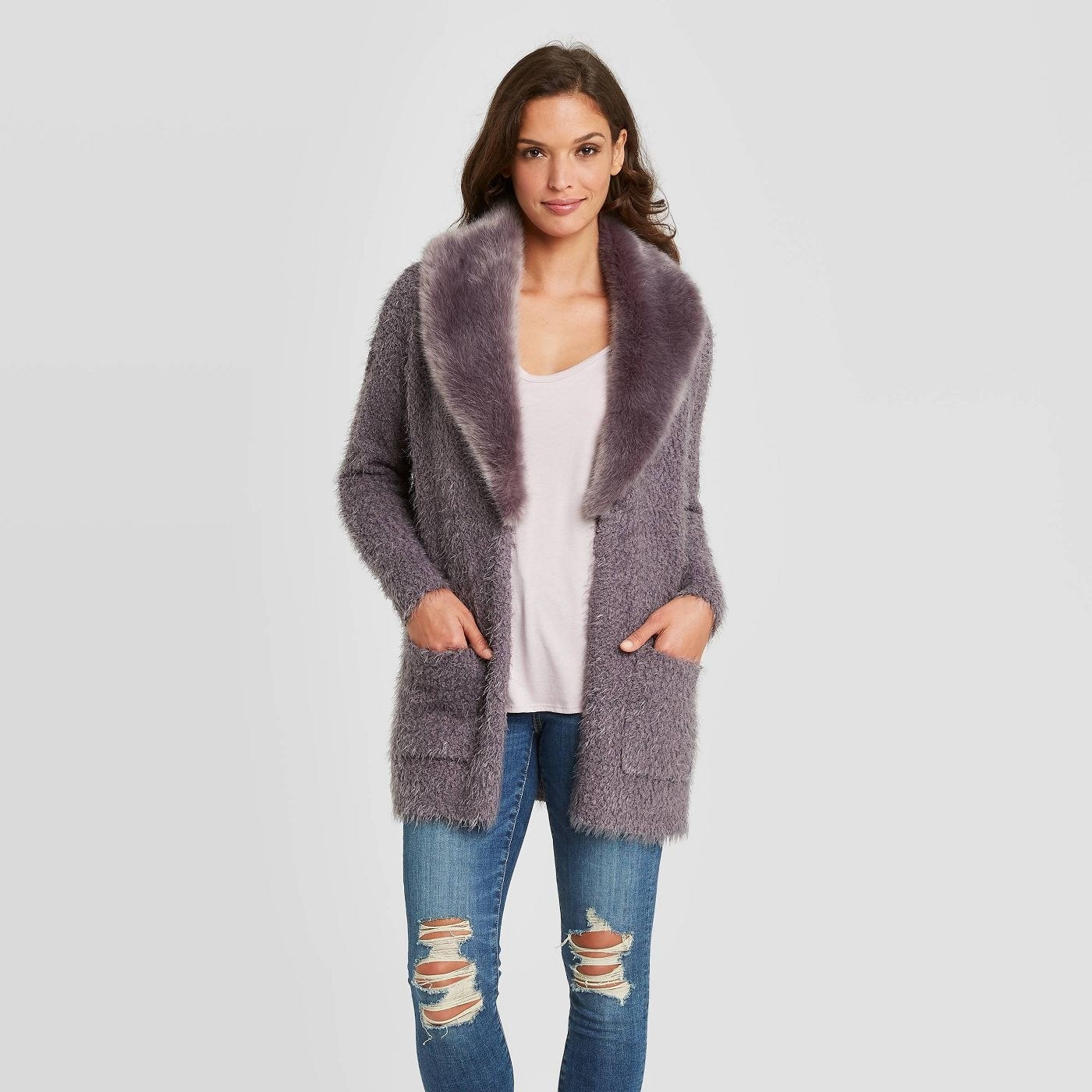 Model in cardigan with removable faux fur collar
