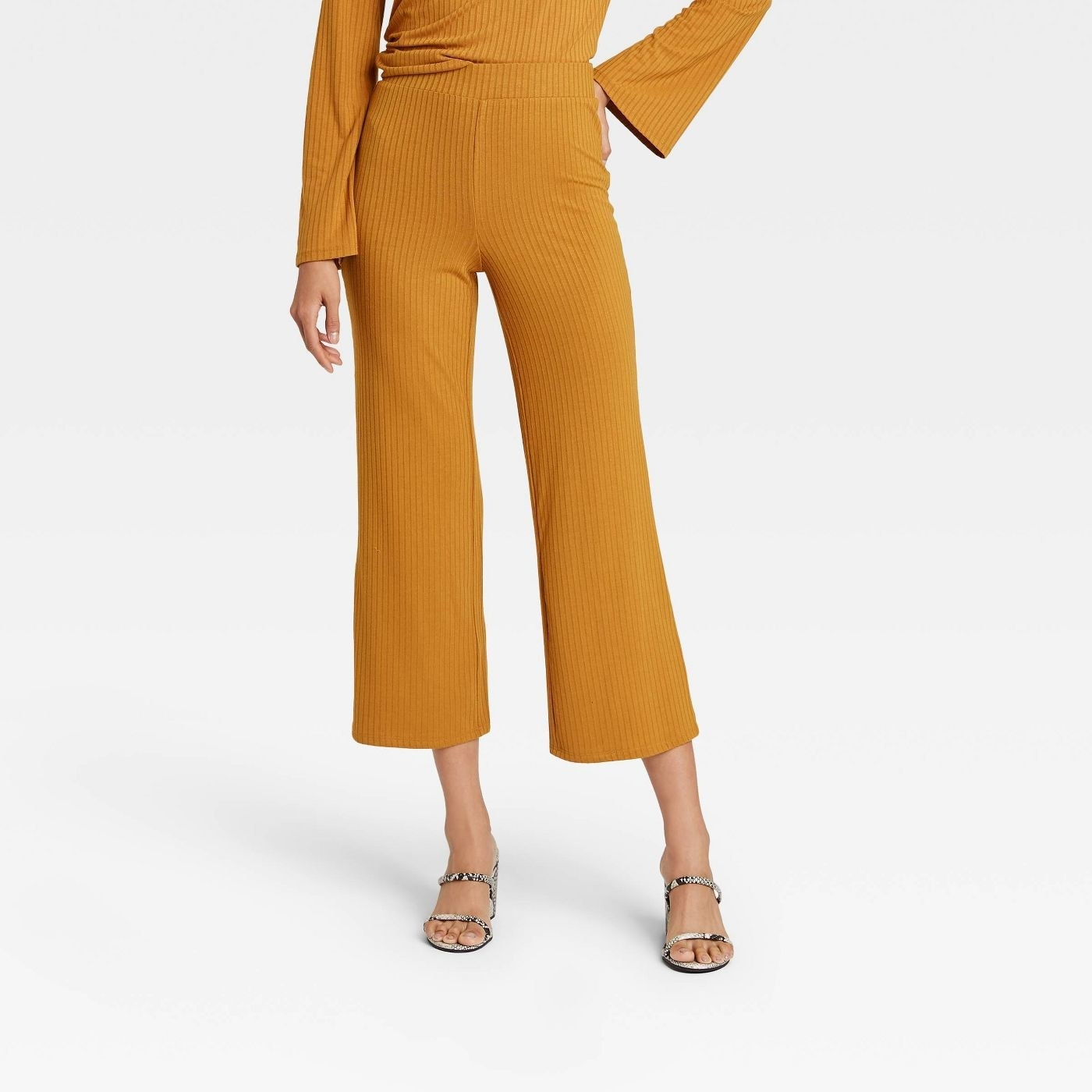 Model in yellow high-rise wide leg pants