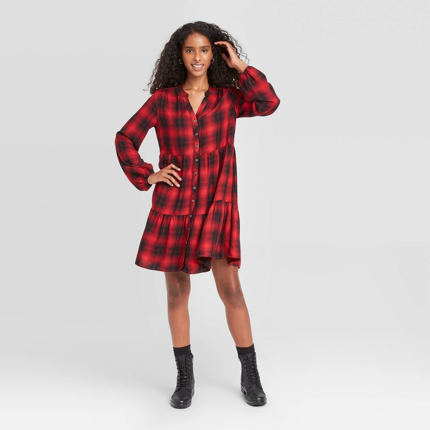Model in plaid puff long sleeve shirtdress