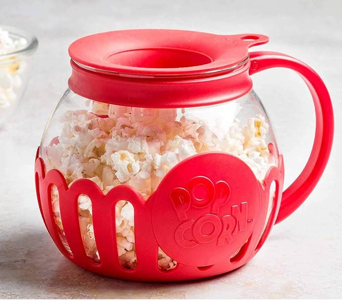 The popcorn popper filled with popcorn
