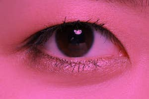 an eye and face that's been color pink