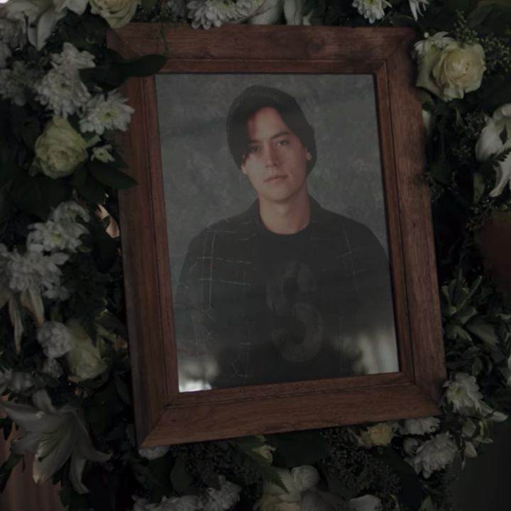 A framed photo of Jughead surrounded by a flower wreath