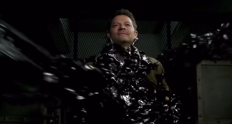 Castiel being enveloped by a black goo-like substance