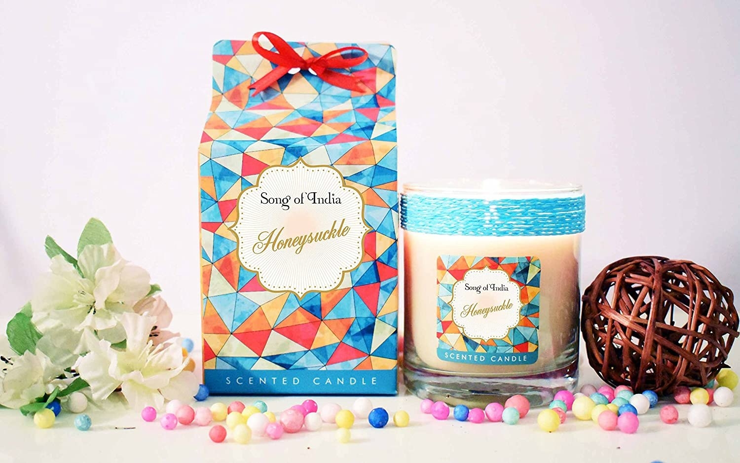 Honeysuckle scented candles with items around it