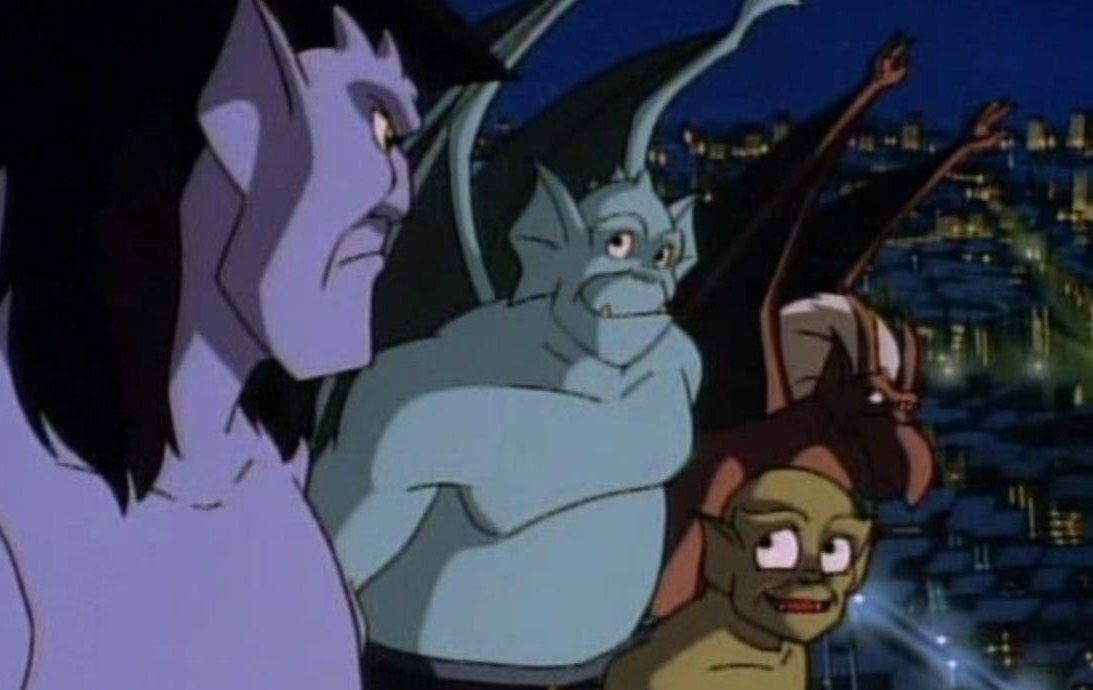 The Gargoyles look at each other with a city in the background