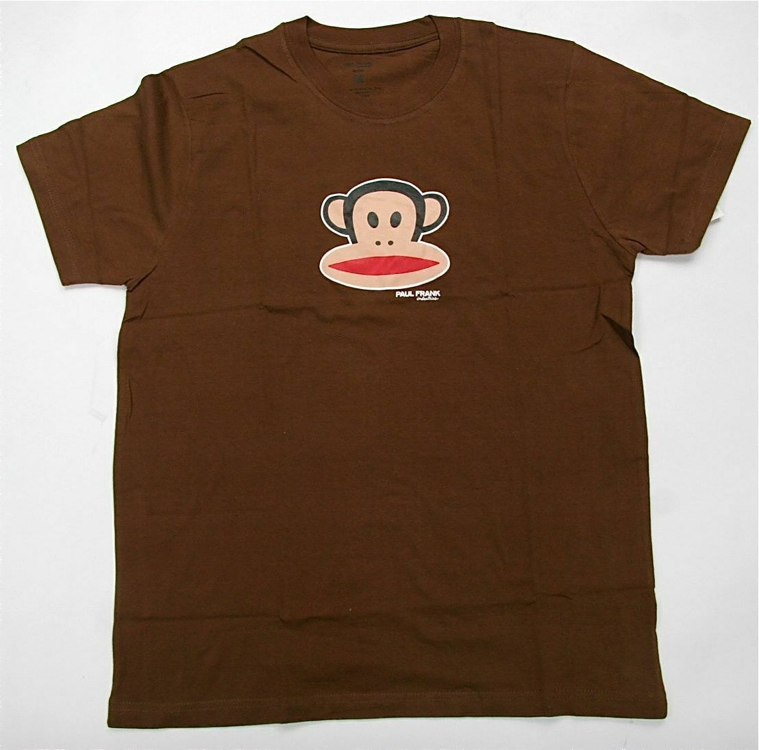A brown T-shirt with a cartoon monkey head on it