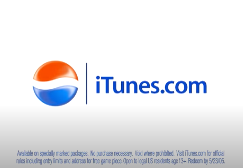 """Screenshot from the commercial of the Pepsi logo next to the words """"iTunes.com"""""""