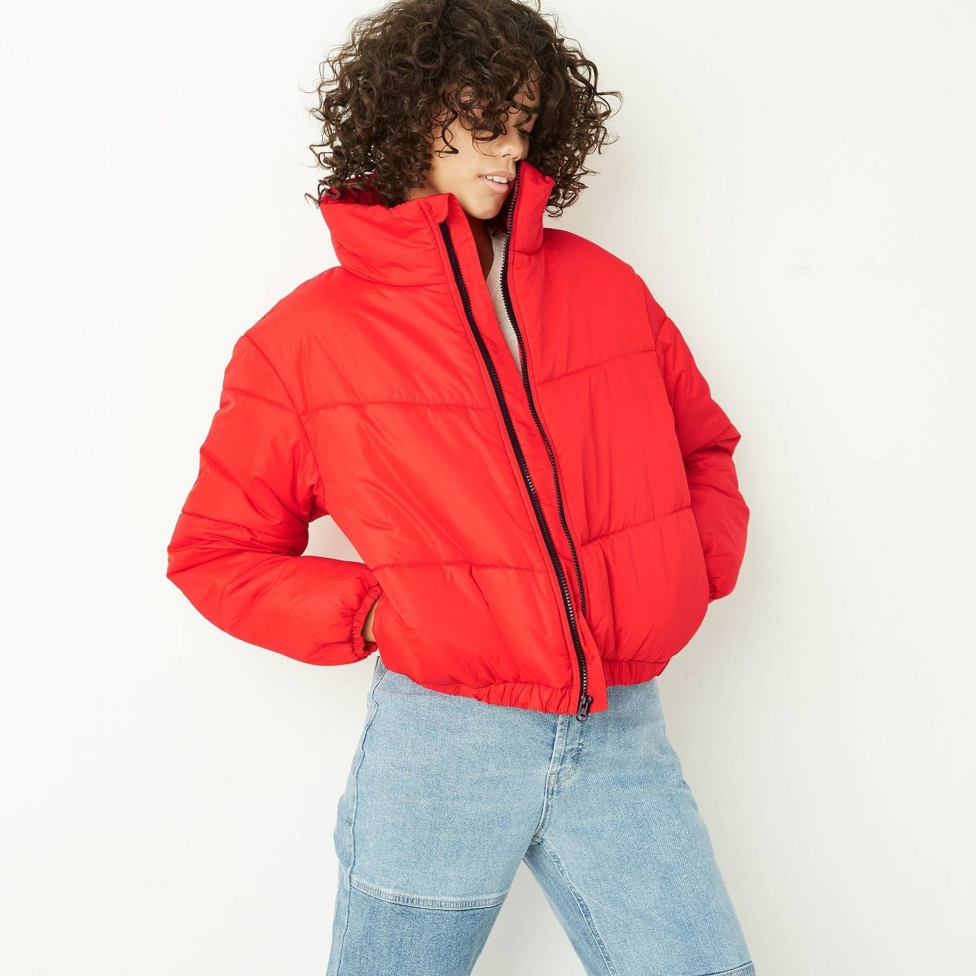 Model in red puffer jacket