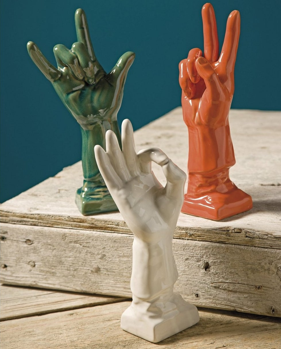 The three hands placed on a wooden crate