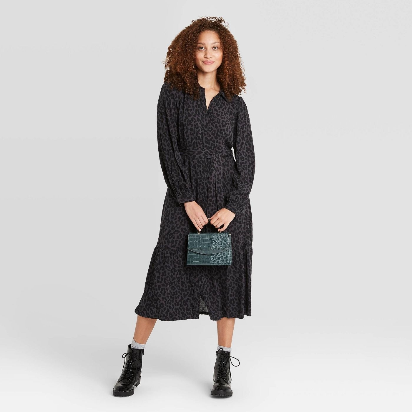 Model in long sleeve tie waist shirtdress
