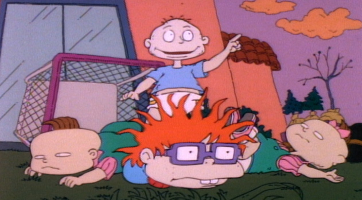 Tommy stands over Chuckie, Phil and Lil lying down