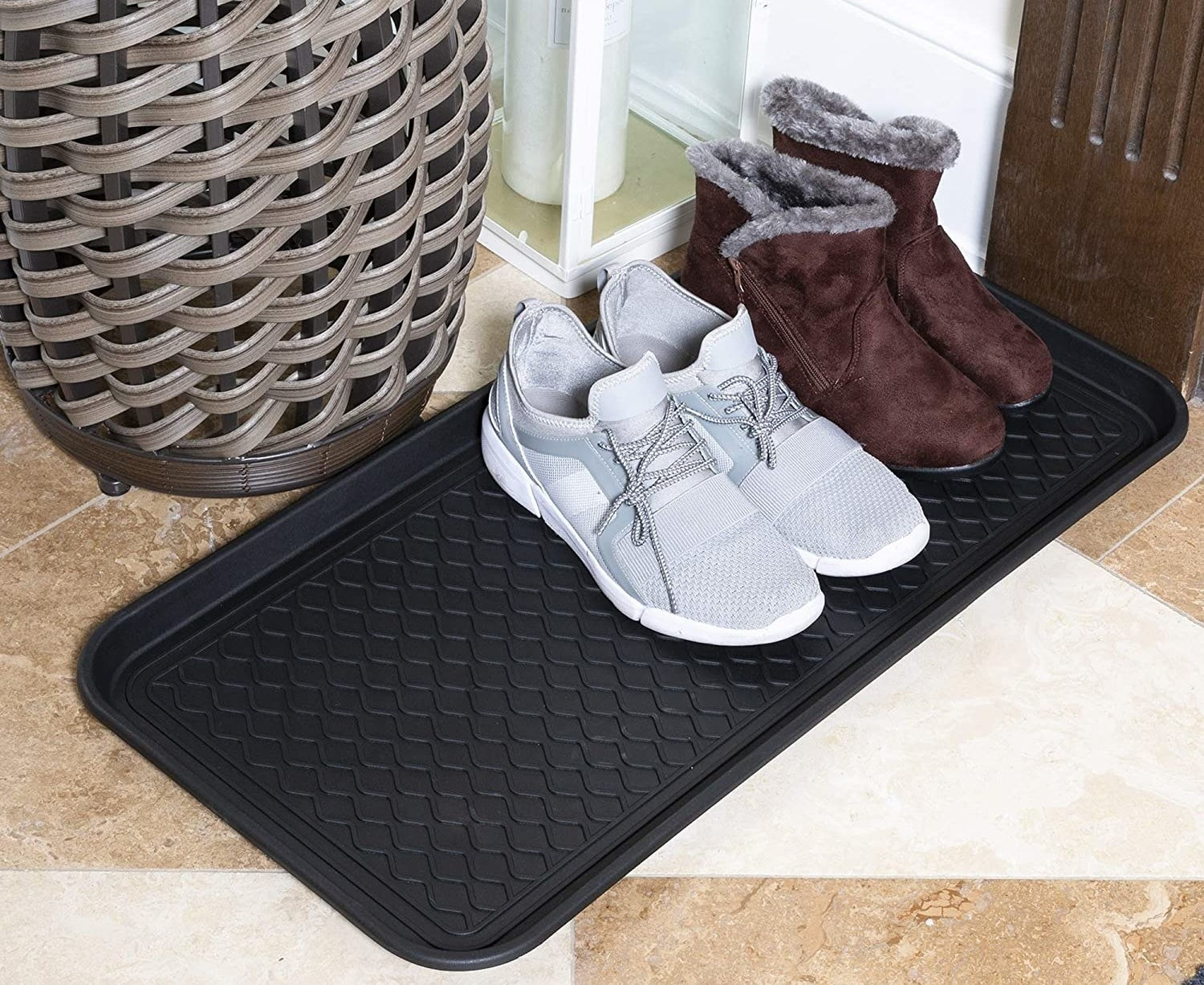 The tray with boots and sneakers on top of it