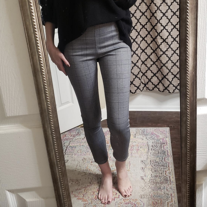 reviewer wearing the gray gingham leggings