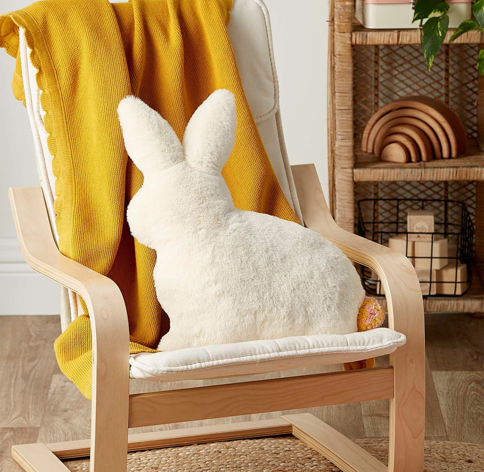 The rabbit pillow on a chair