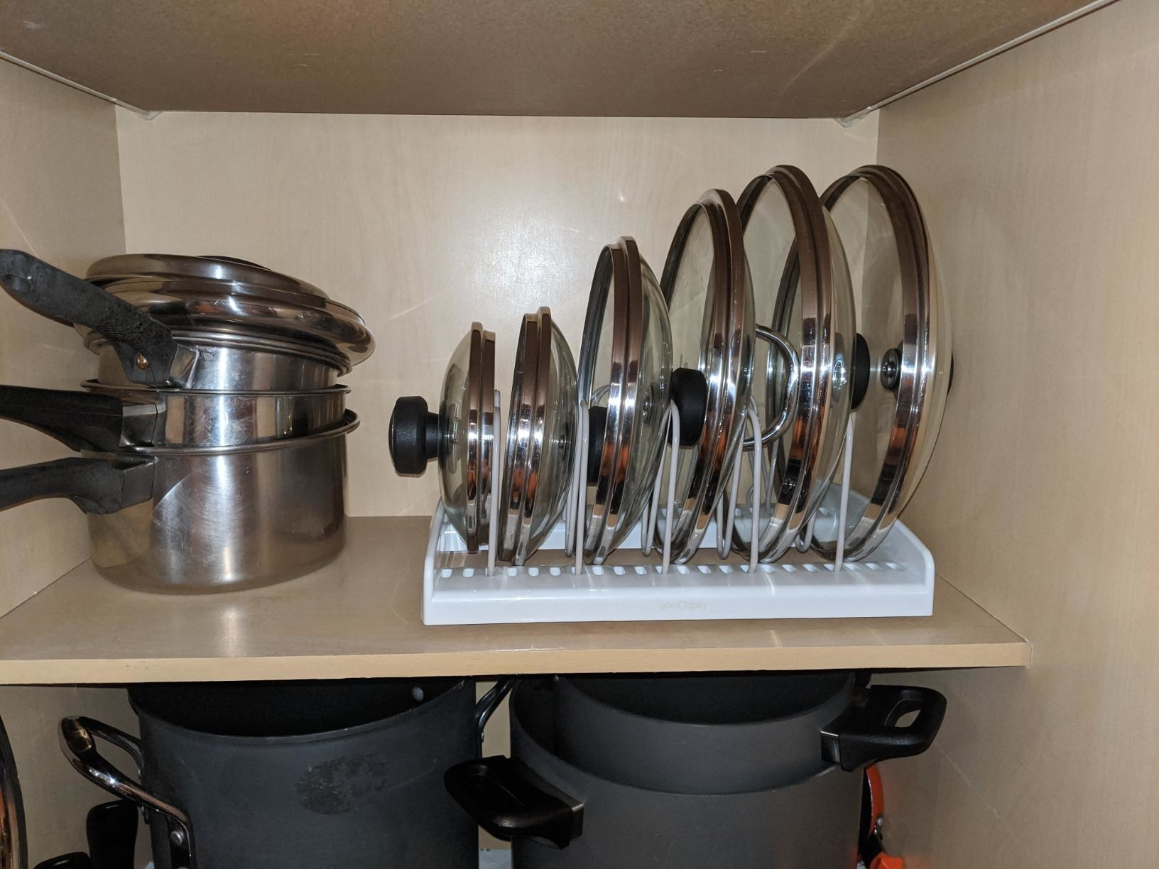 reviewer photo showing lids to pots and pans neatly organized in the bakeware rack