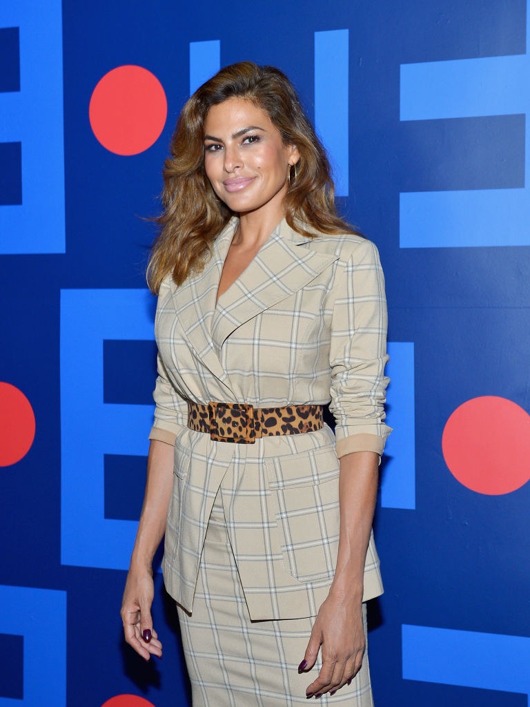 Eva Mendes on a red carpet for a fall holiday fashion show in LA in 2018