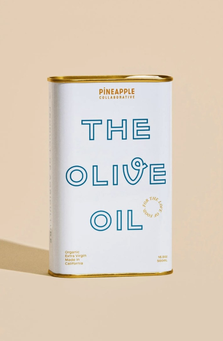 The tin of olive oil in white packaging