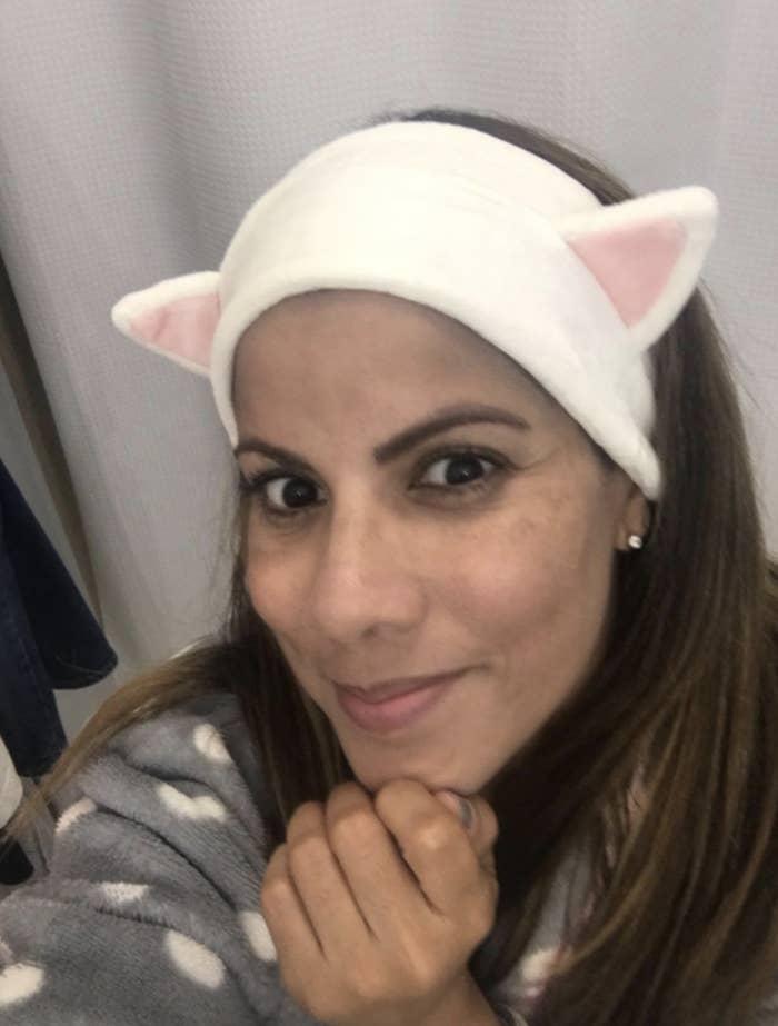 Customer wears kitten headband