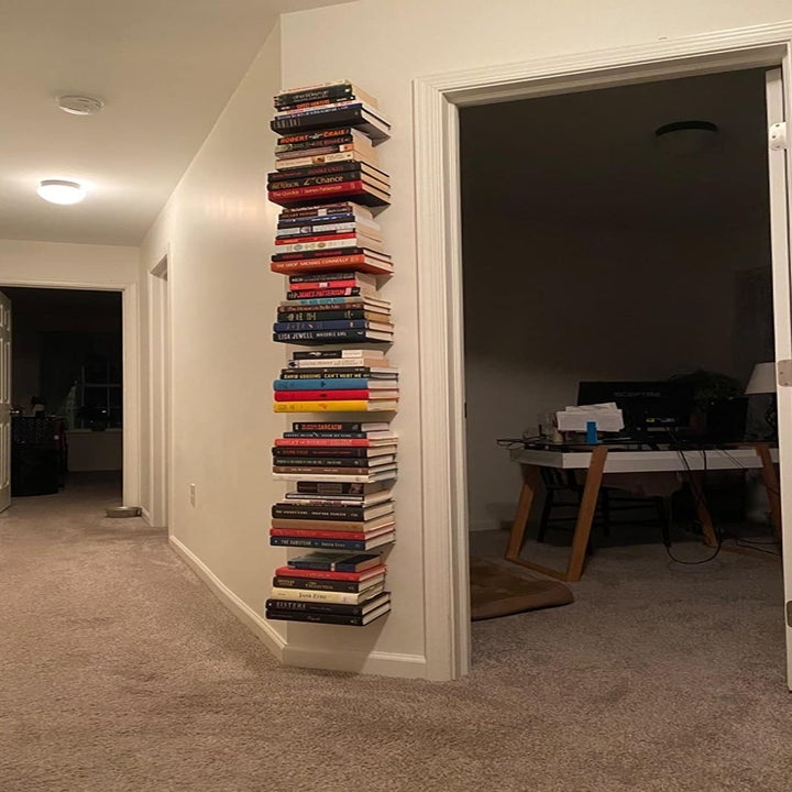reviewer photo showing a stack of floating book shelves filled with several books