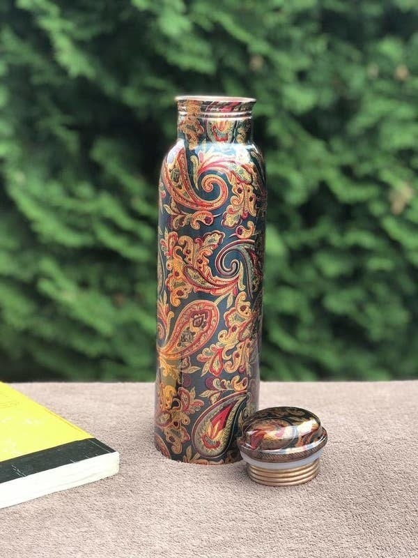 A copper bottle with a gorgeous traditional Bagh design.