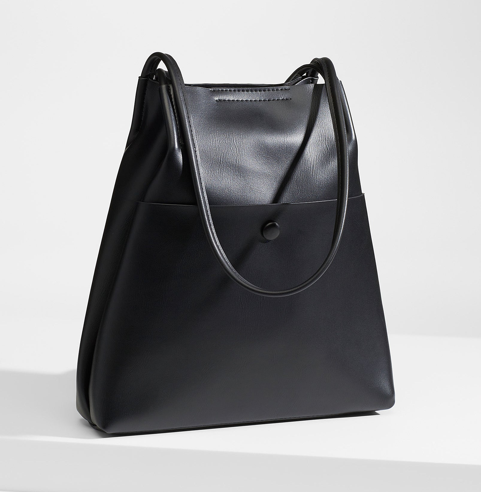 A large faux leather bag with thin long straps