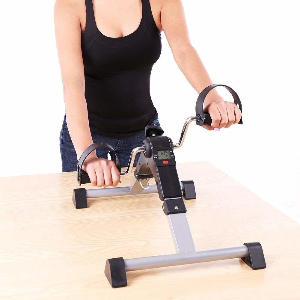 A person using the pedaling machine with their arms.