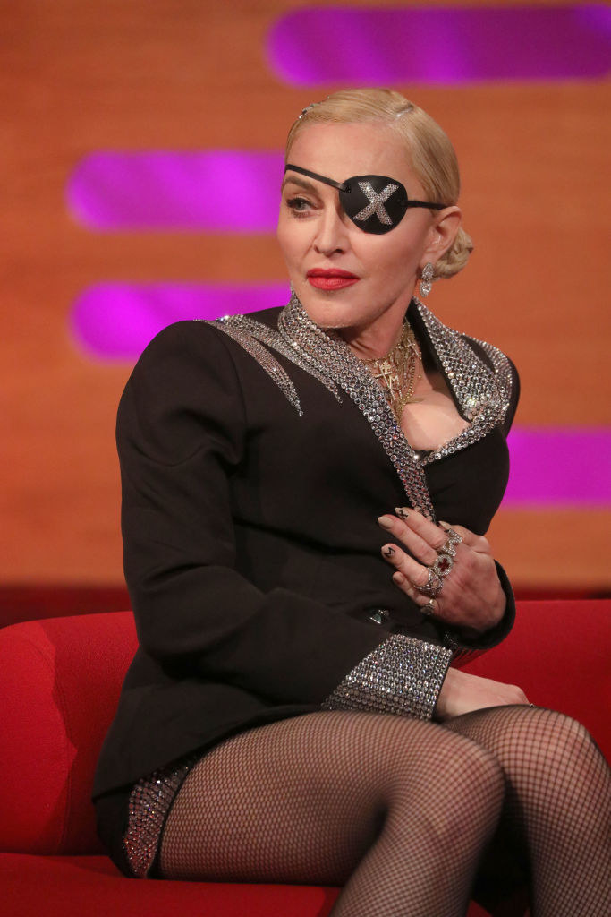 """Madonna on """"The Graham Norton Show"""" in 2019, wearing a glittered suit and an eye-patch"""
